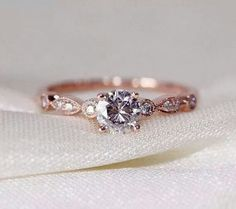 Gold rose ring.  Gorgeous.  Not sure how I feel about the gold for a wedding ring, but the design is beautiful.