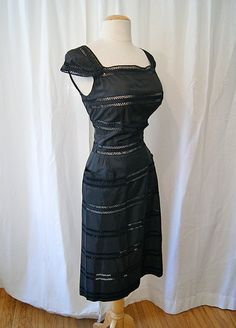 Gorgeous 1950's black taffeta wiggle cocktail dress with see through lace inset bands with hip pockets pin up girl vlxen - size Medium. $165.00, via Etsy.