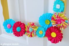 Beautiful ribbon medallions on a fun painted frame -- tutorial on site