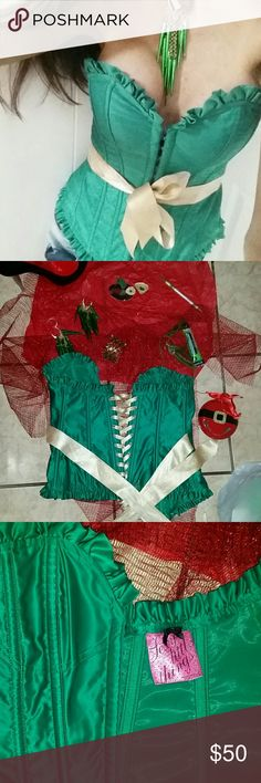 Frederick of Hollywood corset Perfect other than slight staining that may b able to be removed on the attached ribbon belt shown in last pic. It is a small but loosens up as u can see in back as much as necessary. U can zigzag belt or do ur own original thing. It was worn once for st patty day.  Ruffled trim. 100percent polyester.  Beautifully made. Not ur basic corset and can't find anything like it. Green dsnt compliment my skin tone altho I had no complaints w this other than I have a…