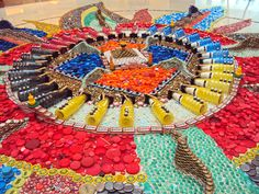 Bottle cap mandalas installation by Bryant Holsenbeck.
