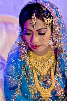 Beautiful Indian Bride with beautiful makeup and dress