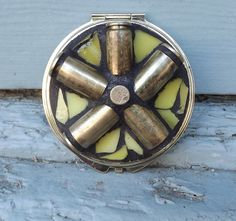 Mosaic Gun Shell Casing Make Up Compact, Double Sided Mirror, Purse Mirror, Round Mirror, Personal Mirror by PiecesofhomeMosaics on Etsy https://www.etsy.com/listing/154011810/mosaic-gun-shell-casing-make-up-compact