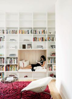 Make your reading nook the feature of your bookcase with this simple white and wood enclave design.