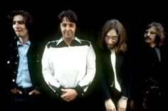 Paul let go.....George is amused......John isn't aware of it...and Ringo is thoroughly disgusted......