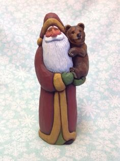 Hand-carved-Santa-holding-cub-bear-by-Susan-M-Smith
