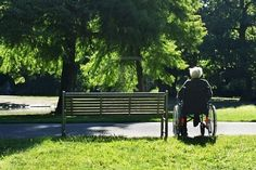 Lonely elderly man sitting in a wheelchair next to a bench. Just taking a moment, would probably change both your lives...forever and for the better :)