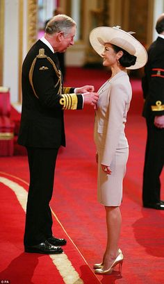 Prince Charles pinned a CBE on Catherine Zeta-Jones's lapel with the minimum of blushes.  She was made a Commander of the British Empire in 2011 for services to the film industry.