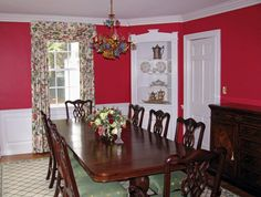 red dining room, white trim and hutch (NOT the furniture or lighting!)