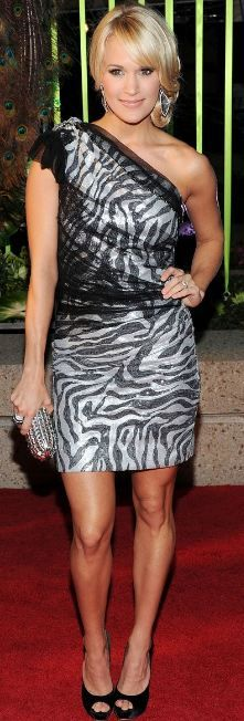Who made Carrie Underwood's clutch, pumps and one shoulder dress that she wore in Nashville on November 8, 2011?