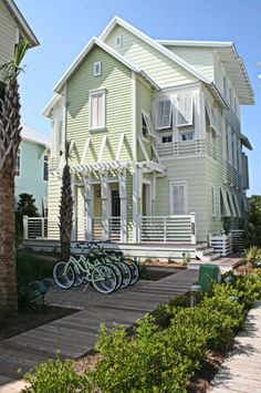 Pale green beach house in WaterColor on the Gulf of Mexico designed by Christ & Associates Architects.