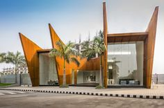 The Crescent, Designed by Sanjay Puri Architects is Situated on a small site abutting a road junction,this single level office building creates a sculptural Solar Shades, Solar Water Heater, Corten Steel, Beat The Heat, Metal Roof, Go Green, Steel Frame, Solar Panels, Land Scape