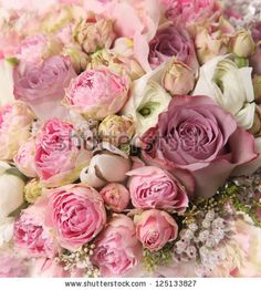 wedding bouquet with rose bush, Ranunculus asiaticus by Julie Boro, via Shutterstock