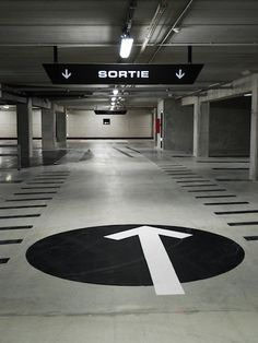 Floor signage in an indoor car park for wayfinding. Floor Signage, Park Signage, Directional Signage, Wayfinding Signs, Signage Display, Signage Design, Car Park Design, Parking Design, Parking Building