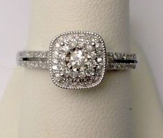 Bejeweled in diamonds. Truly exceed her expectations by proposing love and sealing matrimonial bliss with the 14K white gold engagement ring of her dreams. Her engagement ring encircles a small round diamond center stone with glimmering diamond accents. | eBay!