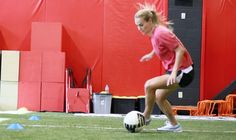 A cool, fun soccer-focused strength and agility building workout with USWNT star defender Heather Mitts.