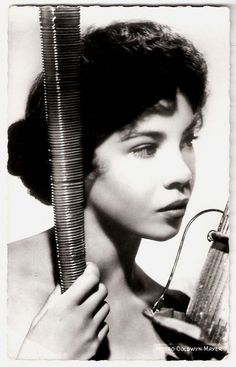 Leslie Caron | French postcard by Editions du Globe, no. 595. Photo: Metro-Goldwyn-Mayer.  French film actress and dancer Leslie Caron (1931) was one of the most famous Hollywood stars in the 1950s. She is best known for the waif-like gamines in musical films like An American in Paris (1951), Lili (1953), and Gigi (1958) . Since the 1960s she's also working in the European cinema.   ...