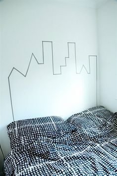 A washi tape headboard from @Hayley Southwood. BJÖRNLOKA RUTA quilt cover and pillowcases http://www.ikea.com/gb/en/catalog/products/70235062/