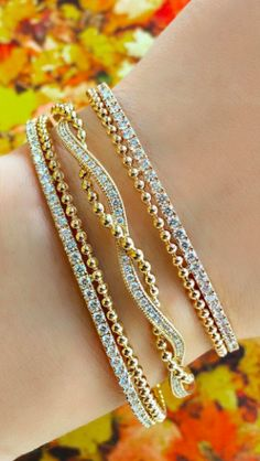Pick up the warm hues of Fall with these stackable bracelets ✨ #danarebecca #diamonds #diamond #finejewelry #jotd  #gold #lovegold #yellowgold #14k #bracelets #design #couturedailydose #fashion #style