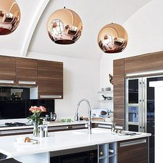 The Shiny Kitchen: Metal Decor for Your Culinary Space  It looks like the copper pendant round lamps are from Tom Dixon. You can find it here: http://www.tomdixon.net/products/us/copper-shade-25cm and can buy it here: http://shophorne.com/content/copper-shade-pendant?source=pjn&subid=73861
