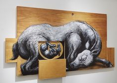 Street artist ROA paints animals on cabinets that open to reveal detailed anatomy.
