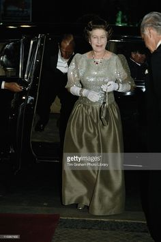 Queen Elizabeth II, wearing a dark green ballgown, to an unidentified event during her five-day state visit to Portugal, 27 March 1985.