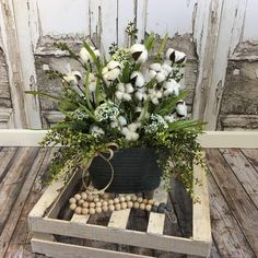 "Cotton boll tabletop arrangement.  Vibrant large cotton  Arrangement in a galvanized planter with wood handles. Cotton stems, Queen Anne's lace, and a beautiful selection of greenery make this piece a showstopper.  Measures 21"" tall and 15"" wide"