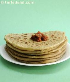 The ultimate comfort food. Eat these plain parathas with subzis and raita and your family and you will surely enjoy it.