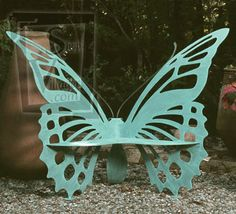 Metal butterfly outdoor bench - whimsical & very cool