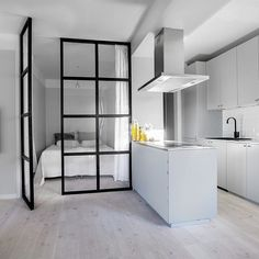 Ohhhh check out this stunning apartment currently accepting bids in by in Stockholm. the metal – glass doors into the bedroom den and the sleek open concept kitchen. Someone buy it already! Studio Apartment Design, Small Apartment Interior, Condo Interior, Studio Apartment Decorating, Interior Design Living Room, Casa Loft, Tiny Apartments, Home Decor Kitchen, House Rooms
