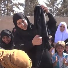 Syrian women burned a burka after being freed from the Islamic State | VICE News