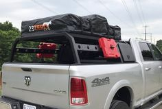"""Our Tech 2 2"""" aluminum expedition rack with removable cross bars, our Nutshell storage boxes, Hi-Lift Jacks and Accessories mount, 2 gallon gas RotopaX and a 23 ZERO USA Bundaberg RTT. www.nuthouseindustries.com Toyota Hilux, Toyota Tundra, Toyota Tacoma, Kayak Rack For Truck, Truck Camping, Truck Accesories, 4x4 Accessories, Truck Canopy, Holden Colorado"""