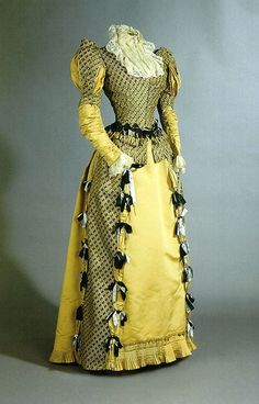 Charles Worth. 1880-1890s dress, seems Renaissance inspired to me.