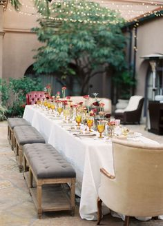 Consider using benches in place of chairs and wild flowers in place of formal arrangements for a more casual appeal. wedding decorations, centerpieces, banquet tables