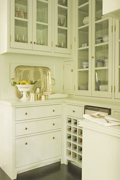 Located adjacent to the dining room or other entertaining space, a butler's pantry allows the host to prep for meals without having to go into the kitchen.