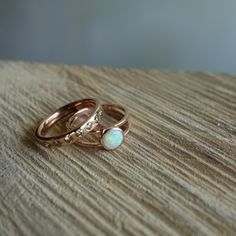 handcrafted with opal, cognac diamonds, and rose gold. uique wedding set - MeritMade