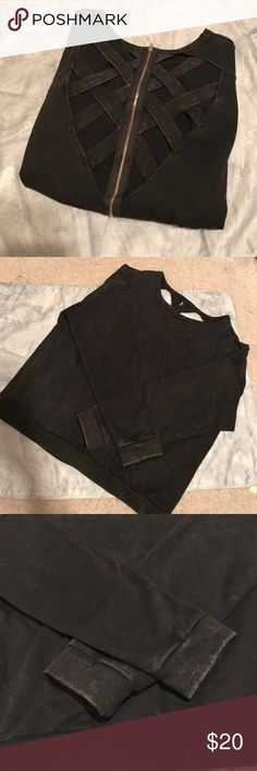 Acid Wash Criss Cross Back Zipper Top This almost black acid wash top is great for fall! Bust out those combat boots because this intricate detail on the back will go perfectly. The top is acid wash, so there is white specs throughout the top for that vintage vibe. Tops