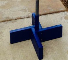 Home made flag pole stand. Great for Cub Scouts. Easy to make. 2x6x8 piece of wood and a 12 inch piece of 1 1/4 PVC pipe used as pole holder. Cut each piece 12 inches long. Sand and paint. Use 3 inch screws to hold together. Takes longer for paint to dry then it does to make flag stand. Wolf elective practice Flag Ceremony at every Den Meeting.