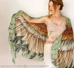 This unique bohemian wings and bird feathers shawl scarf features:  Hand-painted and digitally printed Art of Wide - Spread Wings, this highly detailed representation of Nature, Freedom and Beauty...