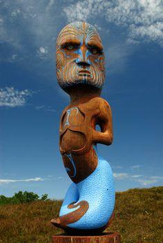 Pouwhenua Maori carved pole of Tangaroa, God of the Sea.