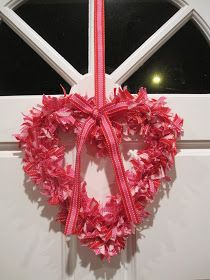 So here is a cute Valentines heart wreath I decided to try...it was actually VERY easy to do, just required a little time and patience!  Fig...