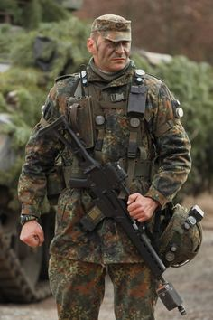 #FaceYourFearAcceptYourWar  Troops of the 37th Armoured Infantry Brigade (37. Panzergrenadierbrigade) await the arrival of new German Defense Minister Thomas de Maiziere at the Bundeswehr combat training center on March 9, 2011 in Letzlingen, Germany. De Maiziere succeeds Karl-Theodor zu Guttenberg and faces the complex task of carrying through much-needed reforms of the German armed forces.