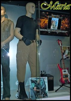 Vin Diesel wore this costume as 'Dom Toretto' when he was introduced in the first The Fast and The Furious movie from 2001.  In Fast Five Dwayne 'The Rock' Johnson joins the film franchise and plays U.S. Diplomatic Security Service (DSS) agent 'Luke Hobbs', in pursuit of Dom and Brian's (Paul Walker) heist team.