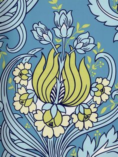 This blue and green floral pattern will add life and color to any room. From the wallpaper book Amy Butler at AmericanBlinds.com