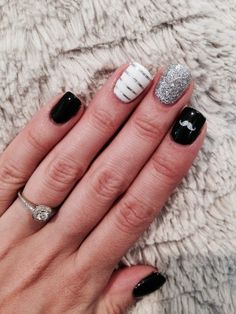 Pinky white and silver ring,middle and thumb black with mustaches and pointer silver