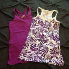 Duo of Purple Tanks Two Racerback tanks. Junior sized. Purple is a medium and printed is a large. Both fit similarly. Tops Tank Tops