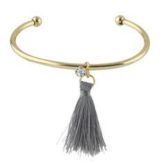 Bracelet jonc tendance. Bijoux fantaisie de créateurs. Magnifique bracelet fantaisie pour femme orné d'un pompon. Un bijou créateur original à petit prix.