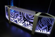 The ClearConsole Cube 66 LED with Modular Wedge additions on either side decorated with custom edge-lit front panel artwork.