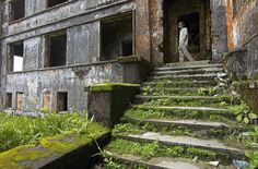 a cambodian man surveys the deteriorating remains of the bokor casino, a popular highland leisure destination for colonials built in 1921 and abandoned in 1940s owing to the first indochina war, and then permanently abandoned in the 1970s with the takeover of the khmer rouge. the casino and surrounding areas was one of the last strongholds of the khmer rouge and the location of a fierce battle with the vietnamese in 1979. the khmer rouge finally abandoned the area in the 1990s.