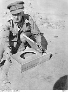 "Tobruk, Libya. 1941-09. A type of latrine used in Tobruk known as ""The Seat of the Army""."